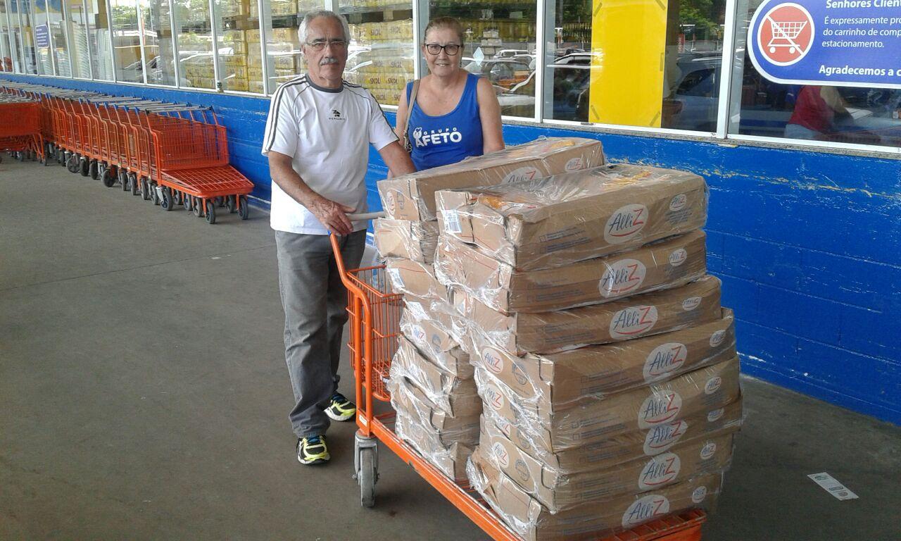 Compra e entrega de frangos para cesta de natal dos haitianos assistidos pela paróquia Sagrado Coração de Jesus